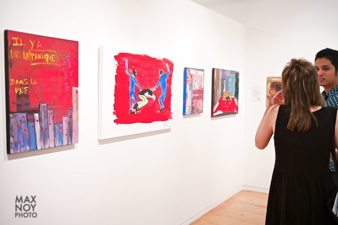 Bold-RED-calls-for-attention-at-art-opening-in-Agora-Gallery